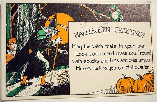Vintage Halloween postcard featuring eerie witch.