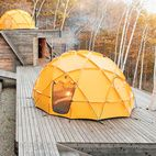 One North Face tent sits atop a deck; another caps the main building, which contains a kitchen and dining area.  Photo by Dean Kaufman.