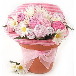 Congratulate new parents with this adorably unique gift bouquet this gift set comes in a flower pot and includes baby essentials folded to look like flowers negle Choice Image