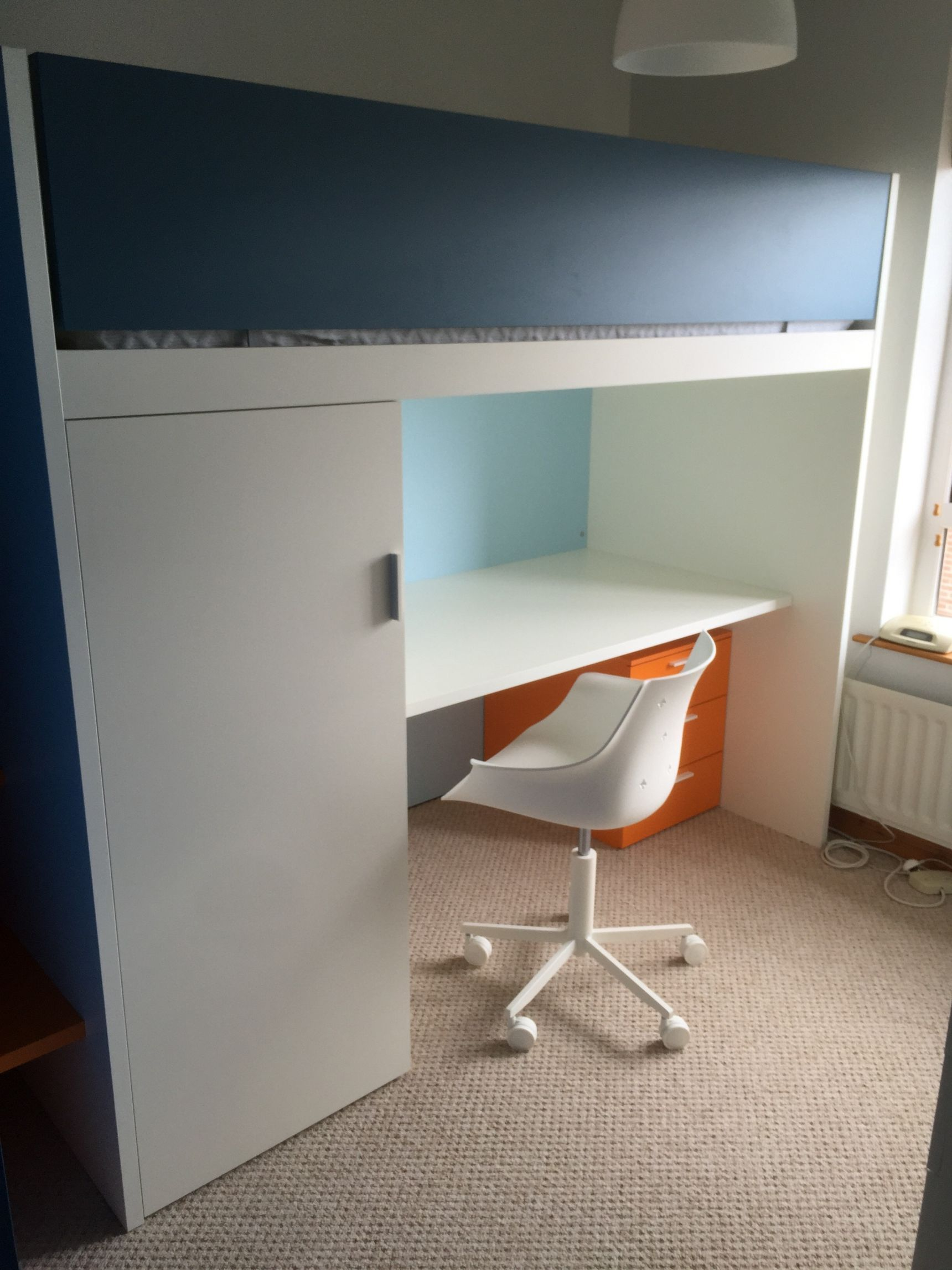 Bunk beds with storage and a desk below is a great way to utilise