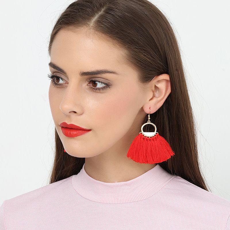 boucle d'oreille pompom rouge