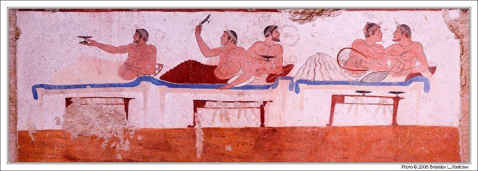 Fresc representant un simposi sobre la paret nord de la tomba del nedador de Paestum.