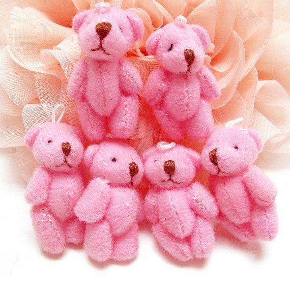 He encontrado este interesante anuncio de Etsy en https://www.etsy.com/es/listing/87490284/5pcs-tiny-baby-teddy-bear-doll-charms