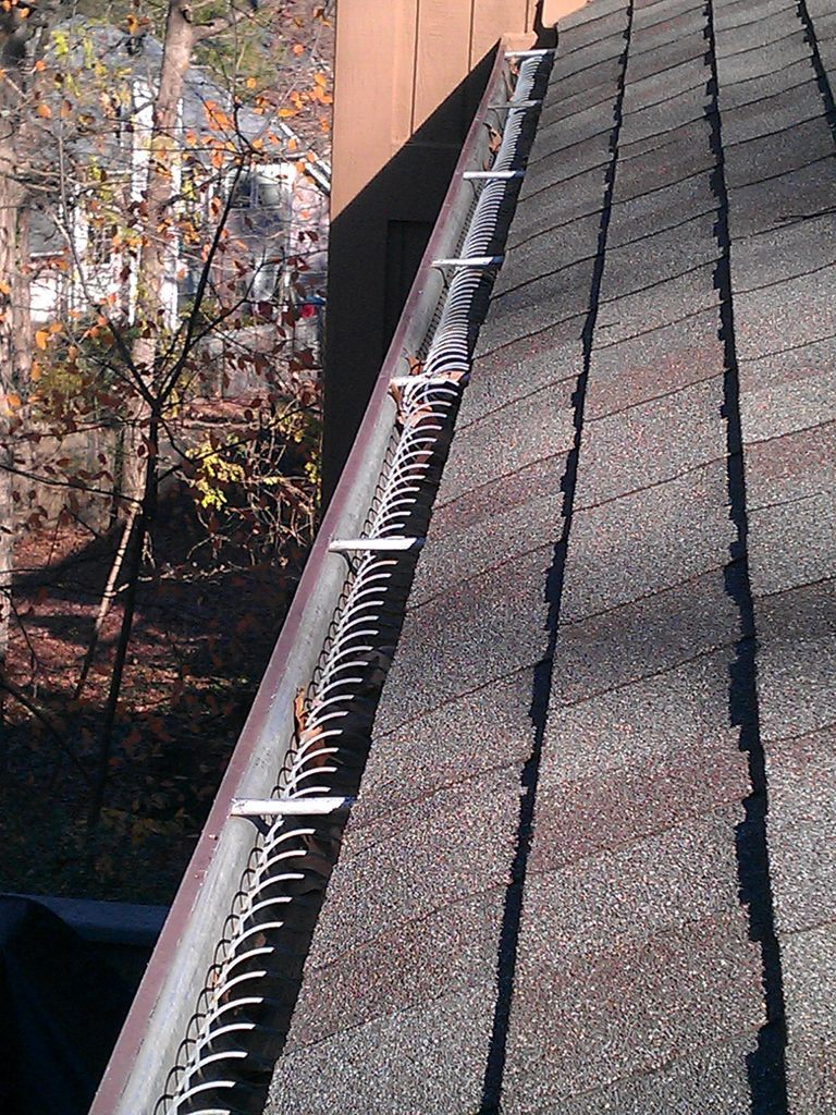 Prevent Gutter Clogging With Slinky No Expensive Gutter Guards Gutter Guard Gutters Diy Gutters