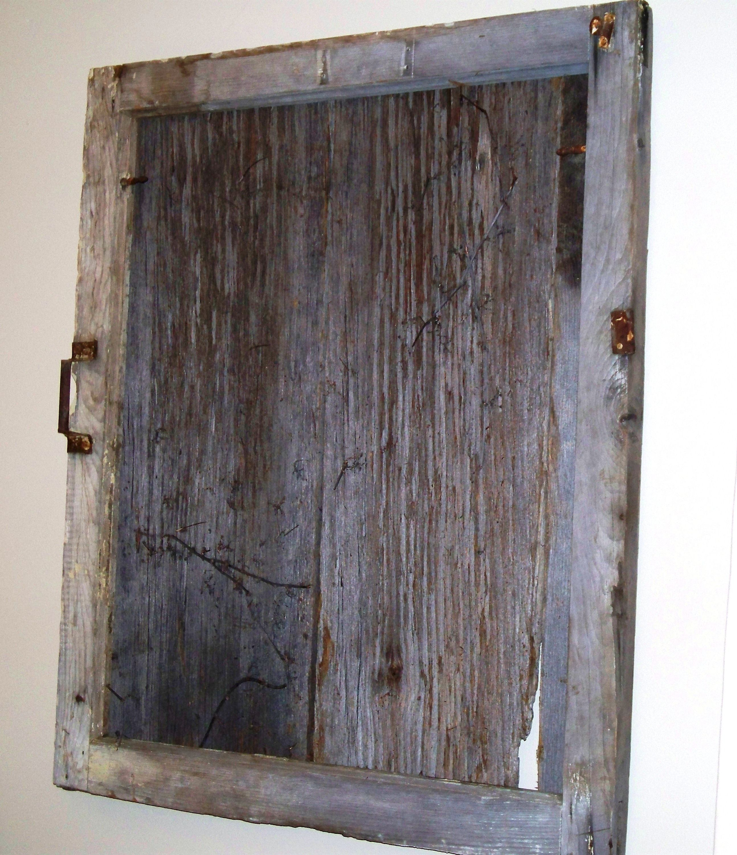 This reclaimed barn window frame makes a wonderful wall decoration. The frame has been filled with siding from the same barn. The siding has vines that have grown into the wood grain over time. To get yours today contact us: kzkustoms@gmail.com
