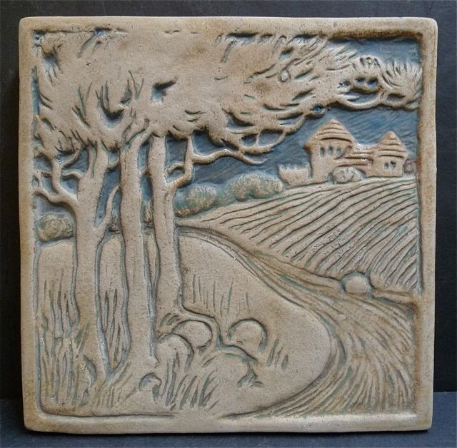 Batchelder Scenic Tile. Batchelder, Los Angeles, CA 1909-1932. The rolling landscape is a pleasing subject found in many Batchelder tiles. This tile has Arts & Crafts styling with simple details in the castle, trees, grounds and rocks. The matte medium-blue glaze in the recesses brings the scene to life with its 3-dimensional feel. Perfect for fireplace surrounds, especially combined with other Batchelder tiles. 8″ square x 3/4″ thick. One available; $900.