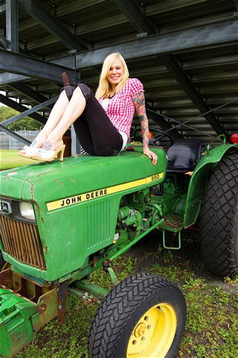 Sexy girl on john deere tractor