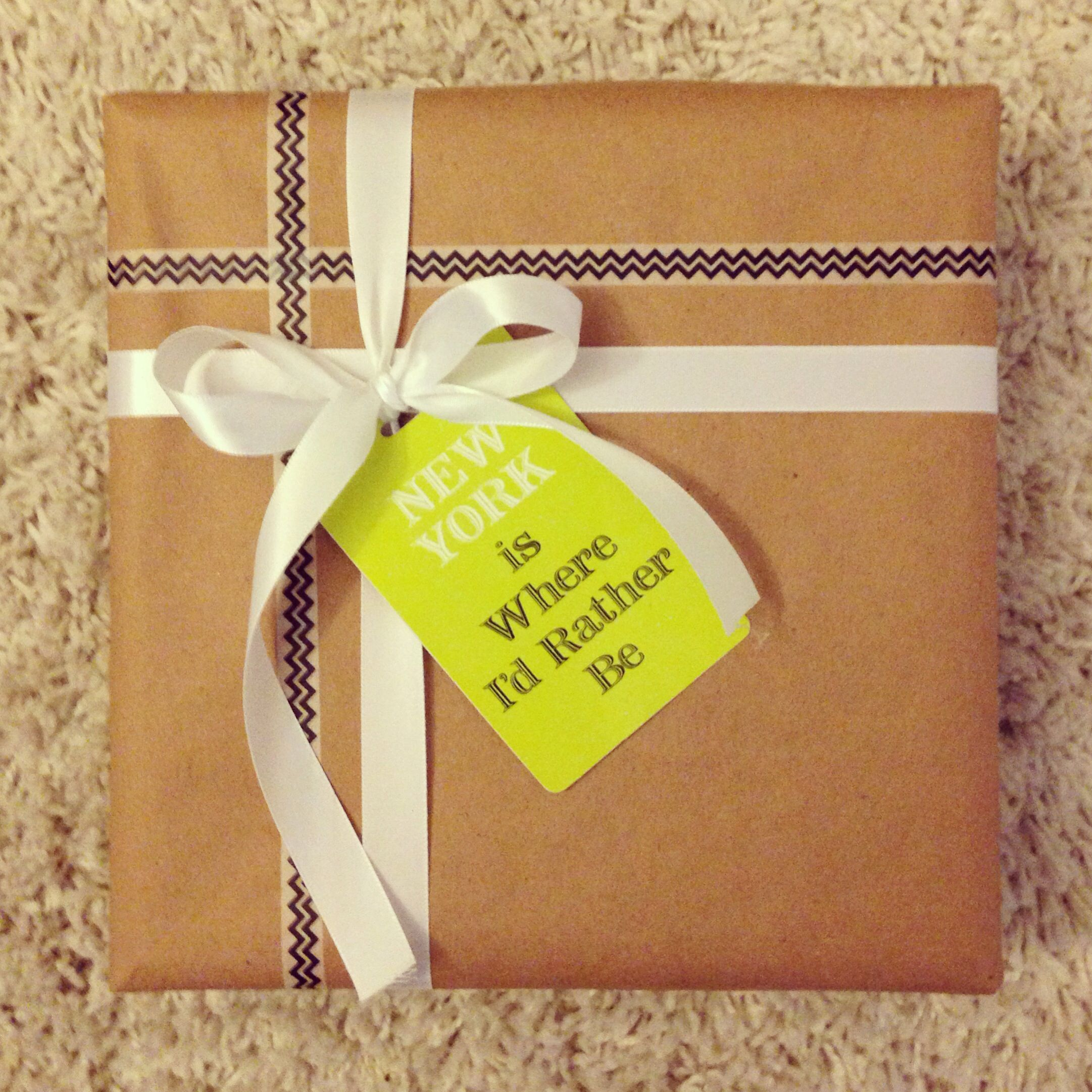 Brown craft paper+ washi tape+ a luggage tag= simple, pretty wrapping