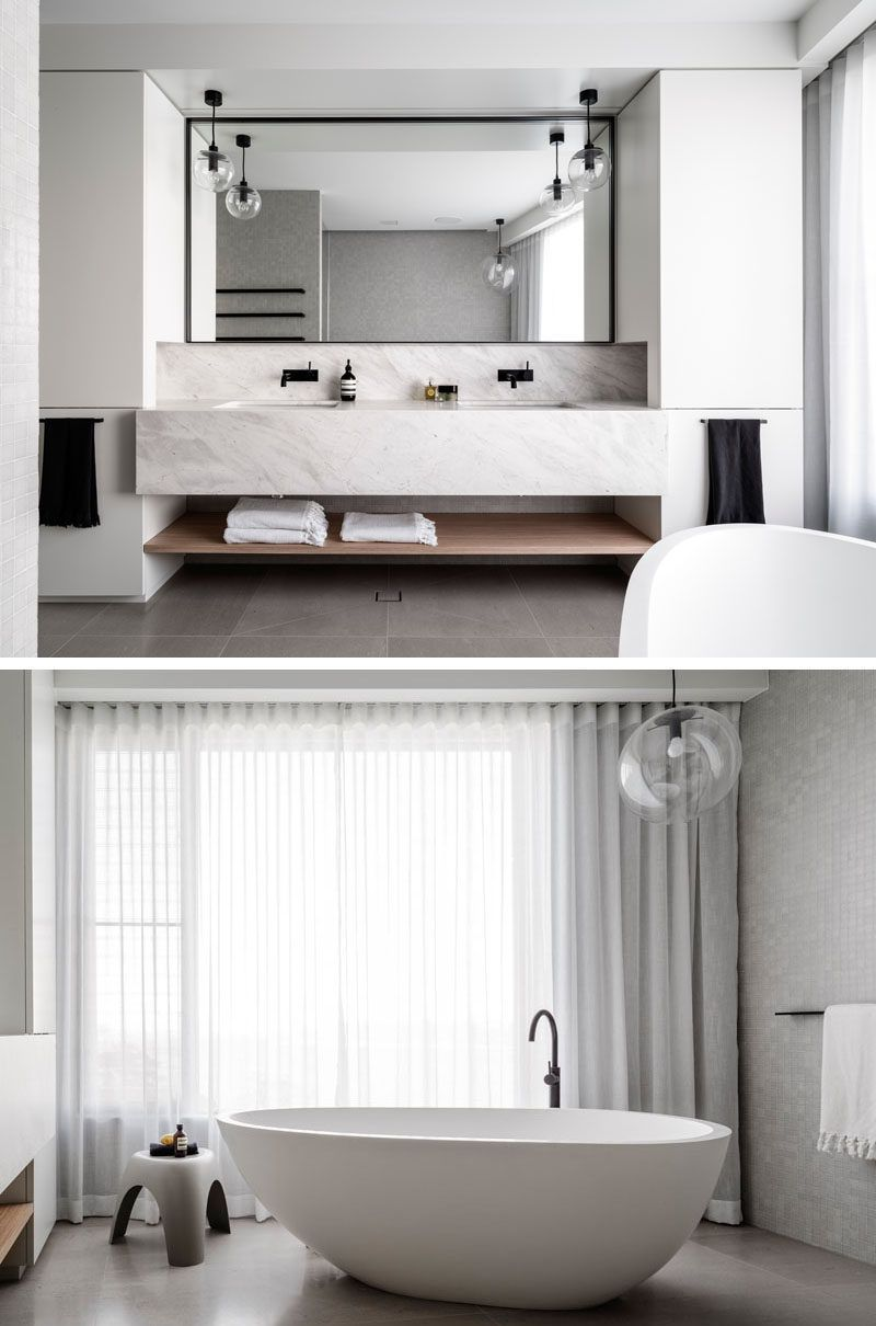 In this master bathroom the vanity has dual sinks a