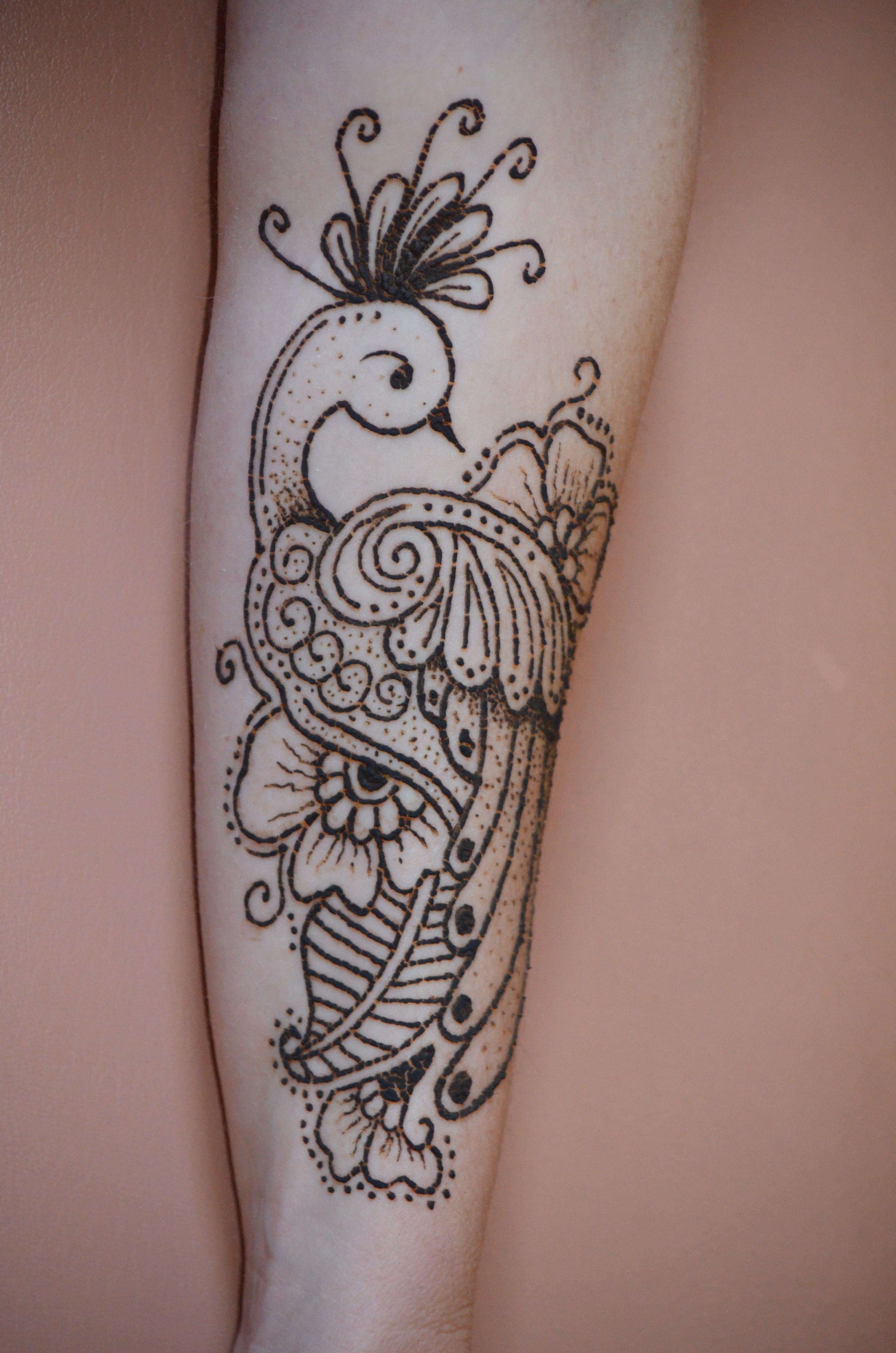 Henna Peacock Tattoo Lower Back: Henna Peacock Tattoo.