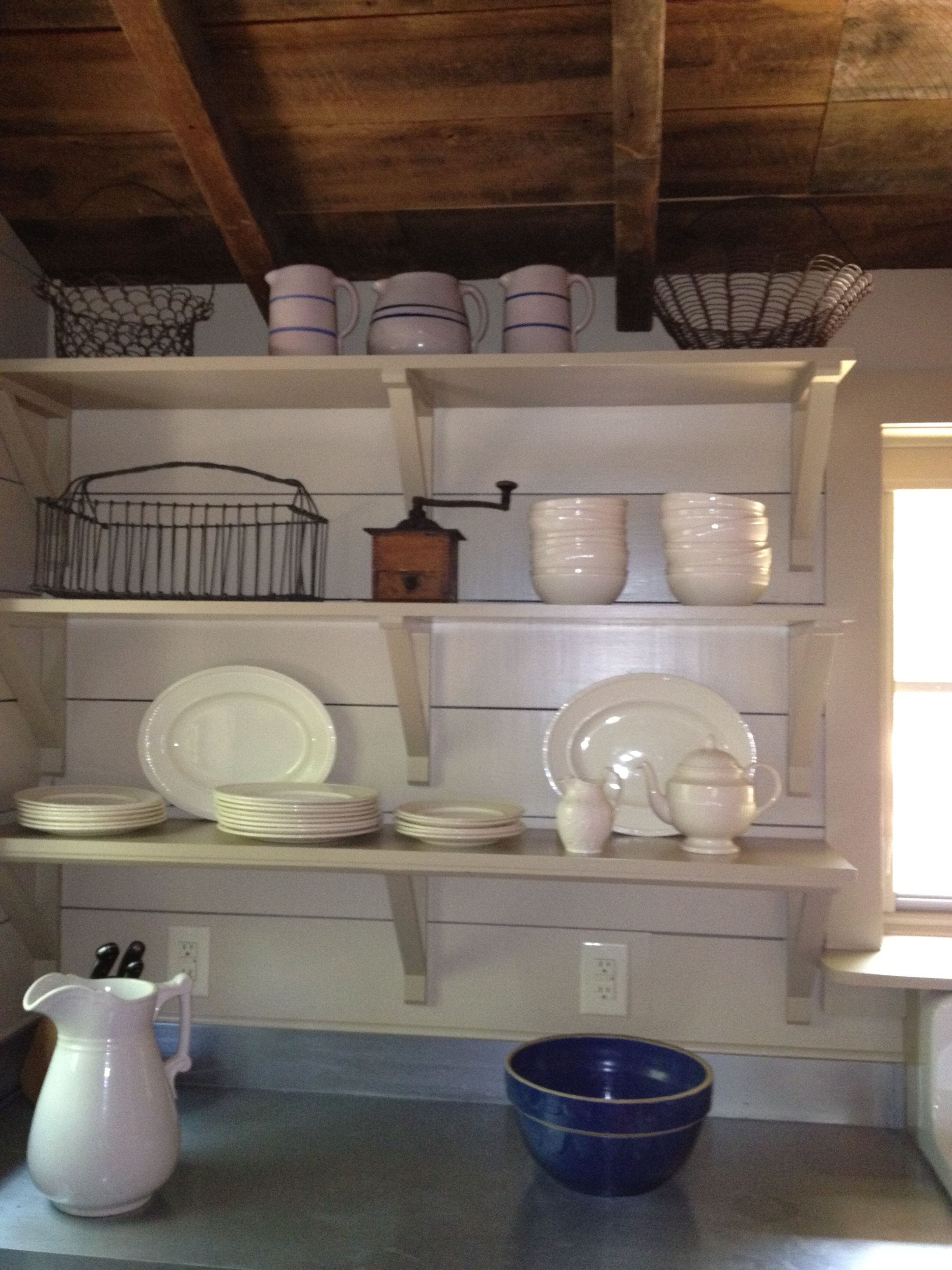 Open shelves in the log house kitchen. The dishes are Wedgwood Edme on log home kitchen tile, tree countertops, log home kitchen colors, log home mirrors, log home railings, log home kitchen cabinets, log home kitchen remodel, log home kitchen layouts, log home outdoor kitchens, log home kitchen appliances, log home swimming pools, log home kitchen additions, log home kitchen curtains, log home custom cabinets, log home remodeling, log home kitchen islands, birch wood countertops, log home concrete countertops, log home ceiling ideas, log home kitchen interior,