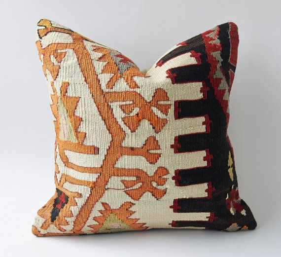 This is a decorative throw pillow is made of Eastern/Central Anatolian Kilim fragments. It is from our newest and most exclusive collection!    Very