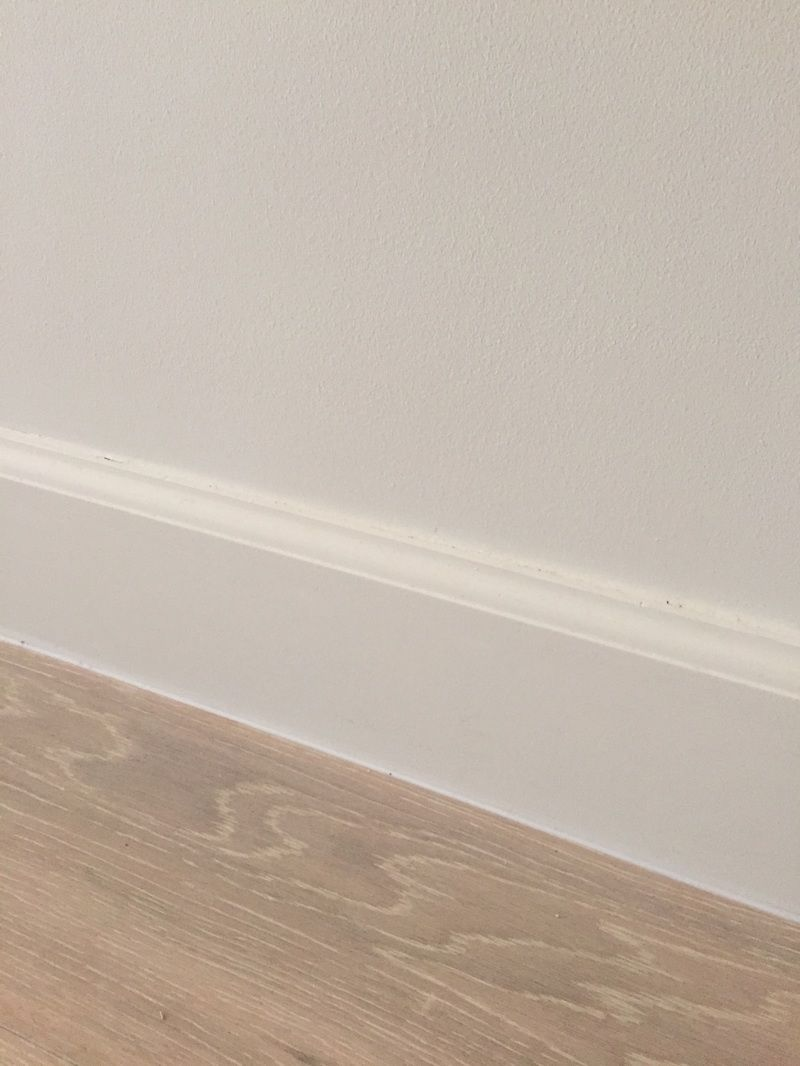 Colonial Style Baseboard Against Oak Floors Baseboards