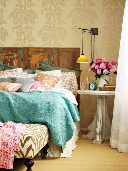 Love the bedding. All of the color, prints and textures just work together, along with the distressed headboard!