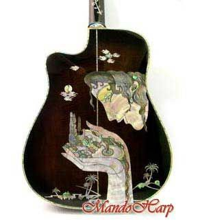 acoustic guitar with beauful hands of Gaia design mother of pearl ...