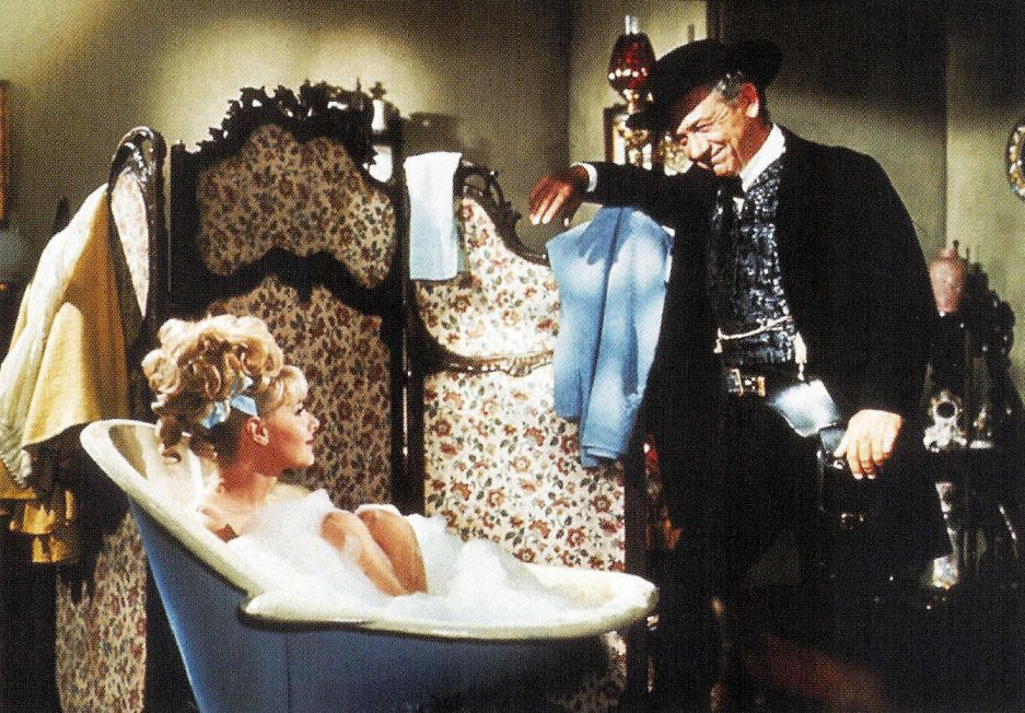 Angela Douglas & Sid James in Carry On Cowboy