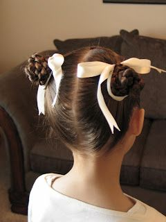 I give it 6 months and Hailey's hair will be long enough for me to do these cute braided buns.