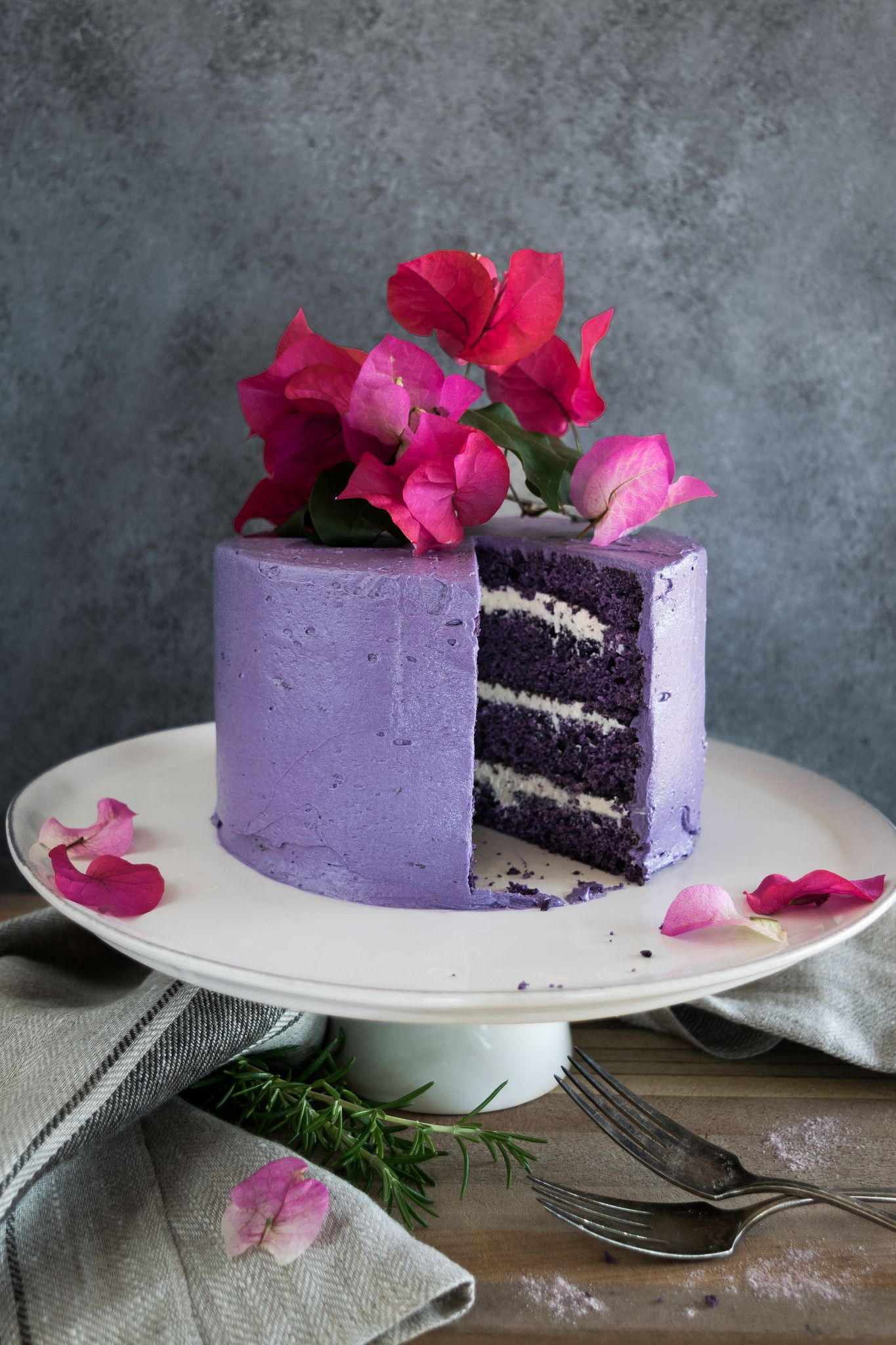 April 7, 2016 - A simple and delicious recipe for ube cake with vanilla marshmallow cream, a festive purple layer cake from Husbands that Cook