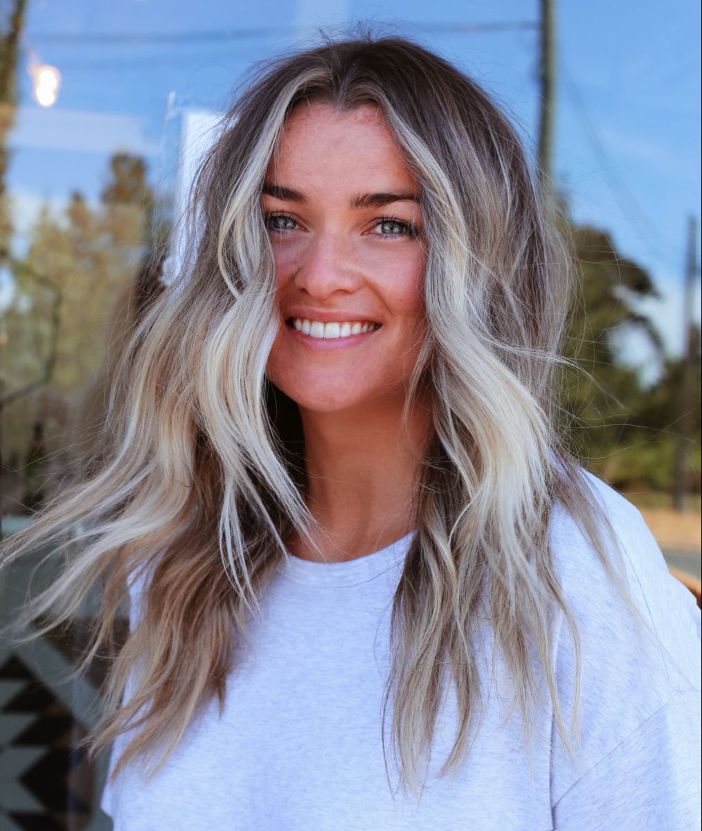 Gorgeous blonde balayage with bright pops around the face