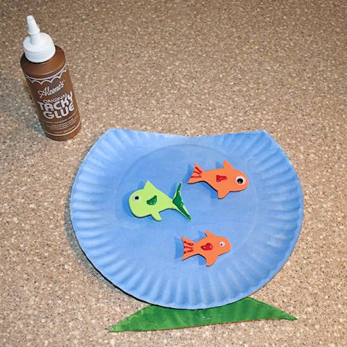 "Read ""Not Norman"" by Kelly Bennett and then make an adorable goldfish bowl with one (or more) fish inside."