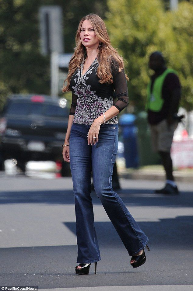 e2367b5f2fc3c All work: Sofia Vergara wore a tight pair of 7 For All Mankind jeans on the  set of her TV show Modern Family in LA on Tuesday