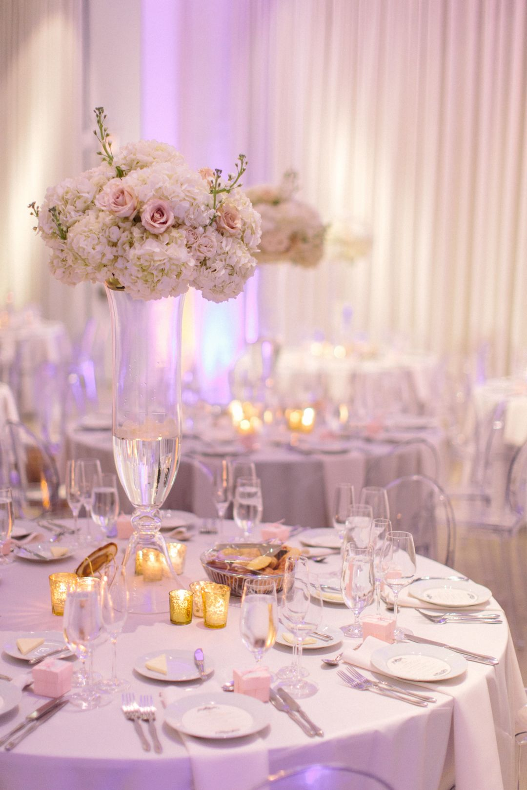 Wedding decor with ghost chairs  Minimalist and elegant wedding reception decor with white linens