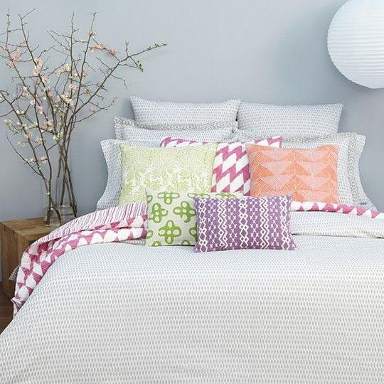 This isn't what I have now but love the look for the new space! Love the gray walls with the bright pillows. Good for spring