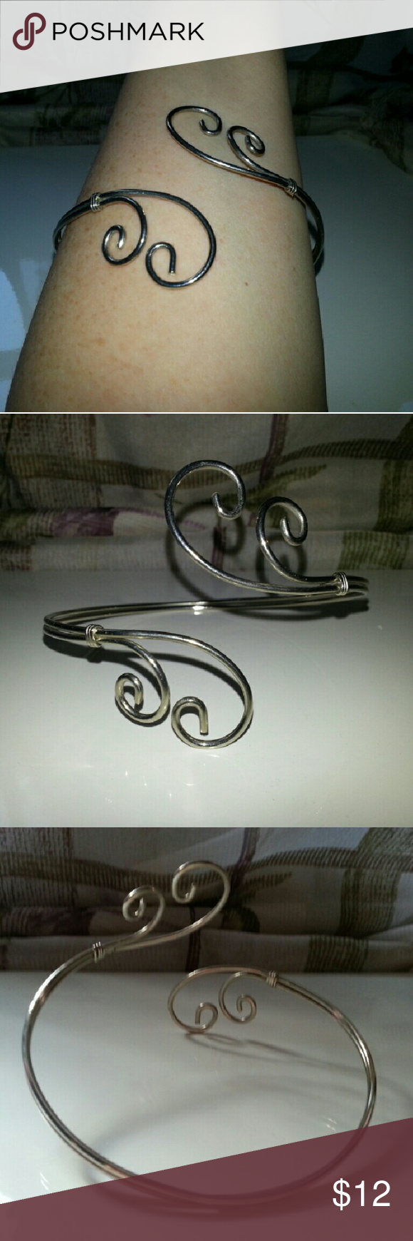 Awesome Upper Arm Cuff Double swirl silver toned upper arm cuff. Straight from the mid-90's. I rocked this at Lilith Fair! Add a babydoll dress and combat boots and you'll be all set! Jewelry Bracelets