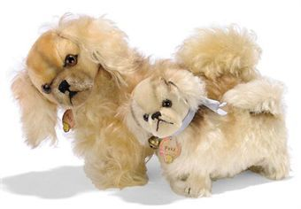 TWO STEIFF STANDING PEKYS, (1317,02 and 1322,02), one golden and one white mohair, brown and black glass eyes, black stitching, swivel heads, the larger with a large squeaker, the smaller squeaker inoperative, FF button, smaller with yellow cloth tag and chest tags, 1930s --13in. (33cm.) and 9in. (23cm.) long (some slight wear, smaller chest tag worn)