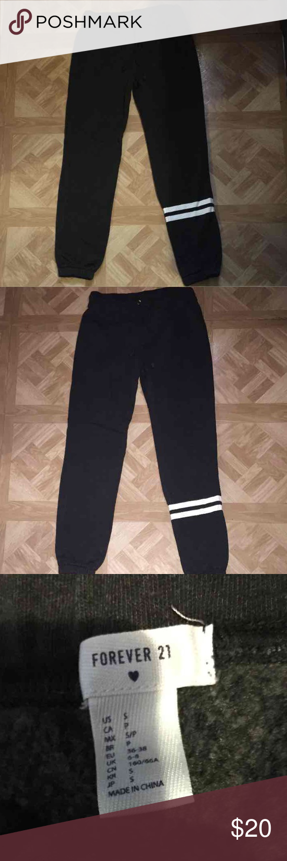 Forever 21 Skinny Jogger Sweatpants Dark charcoal grey color, Almost black With two white stripes on right leg Super soft and comfy Womens size small     Like New Condition Forever 21 Pants Track Pants & Joggers