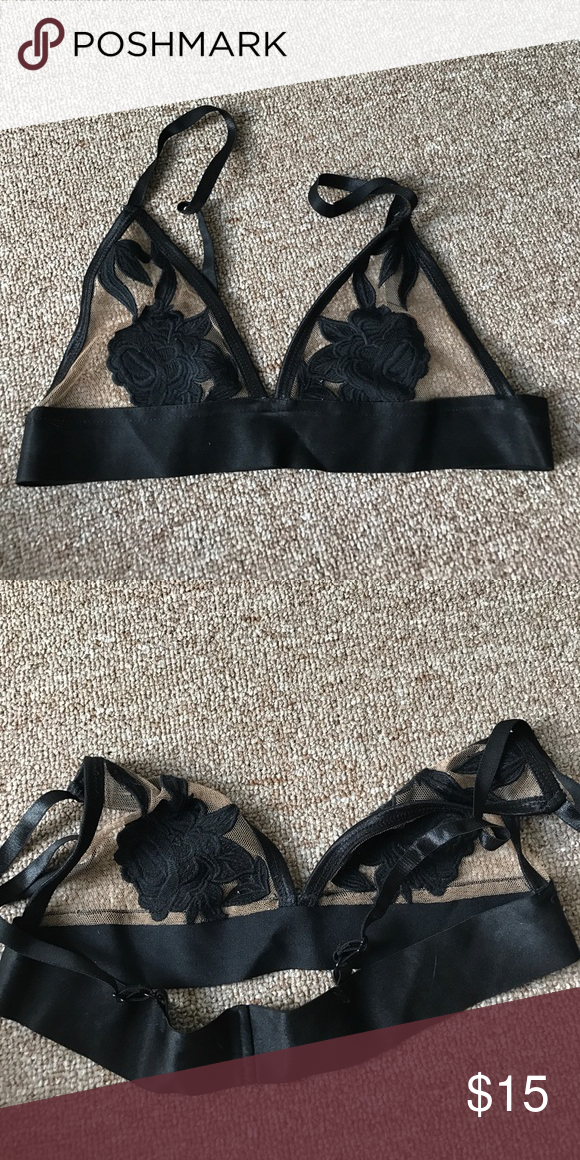 8f3f86b522 Black bralette with nude mesh and floral appliqué Sheer bralette with black  floral appliqué. Best for smaller busts. Never worn. Elastic band.