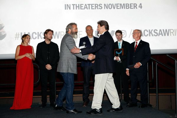 """Mel Gibson Photos Photos - Mel Gibson and Desmond Doss Jr. attend the """"Hacksaw Ridge"""" special screening at the National World War II Museum on October 26, 2016 in New Orleans, Louisiana. - 'Hacksaw Ridge' New Orleans Screening and Medal of Honor Event"""