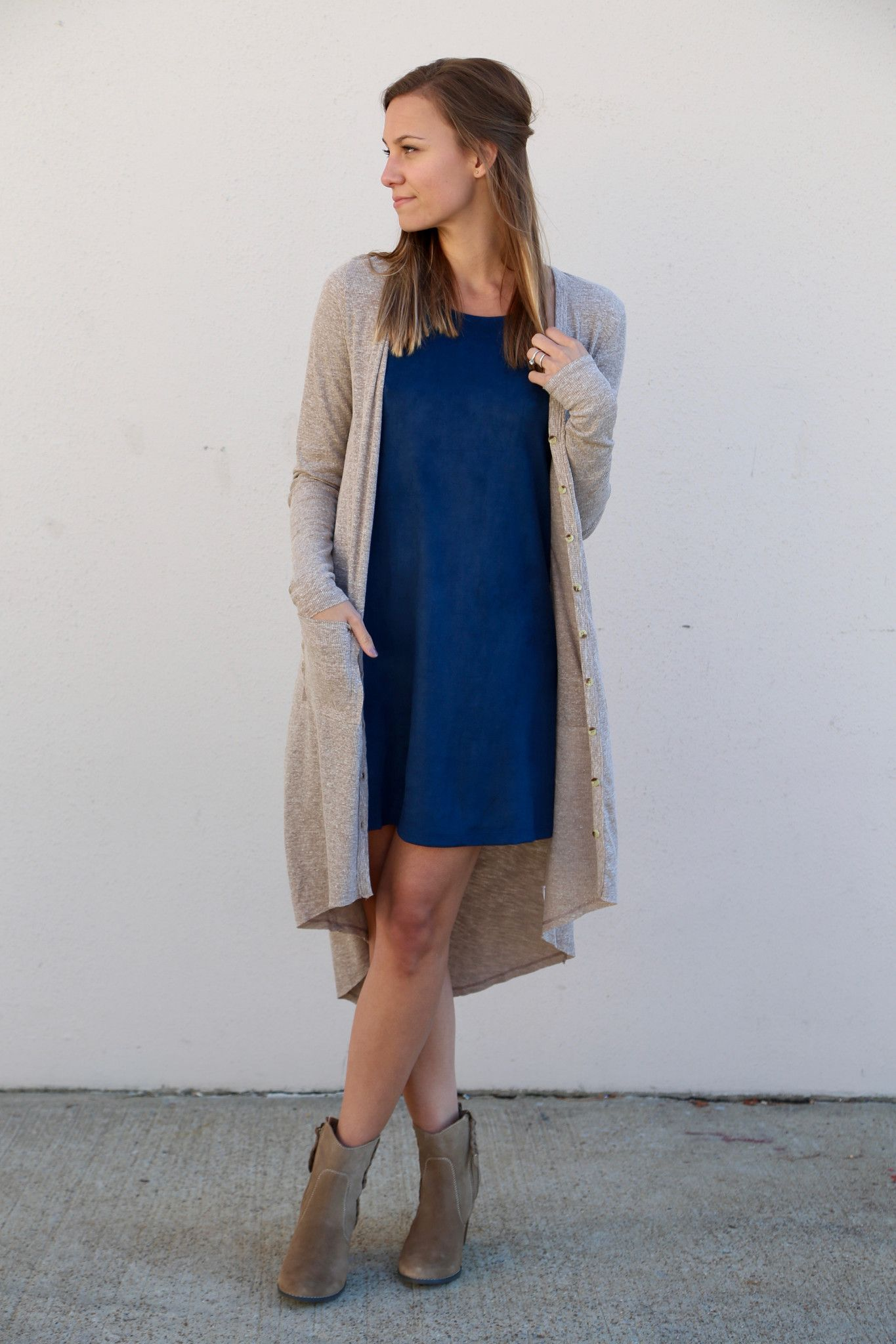 We adore this long cardigan paired with our 'Midnight Blue Suede Dress.' Cotton/polyester blend. Oatmeal in color. Cardigan with button-down front closure. Model in this photo is a 2/3 and is wearing