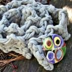 grey knitted scarf with handmade circles button
