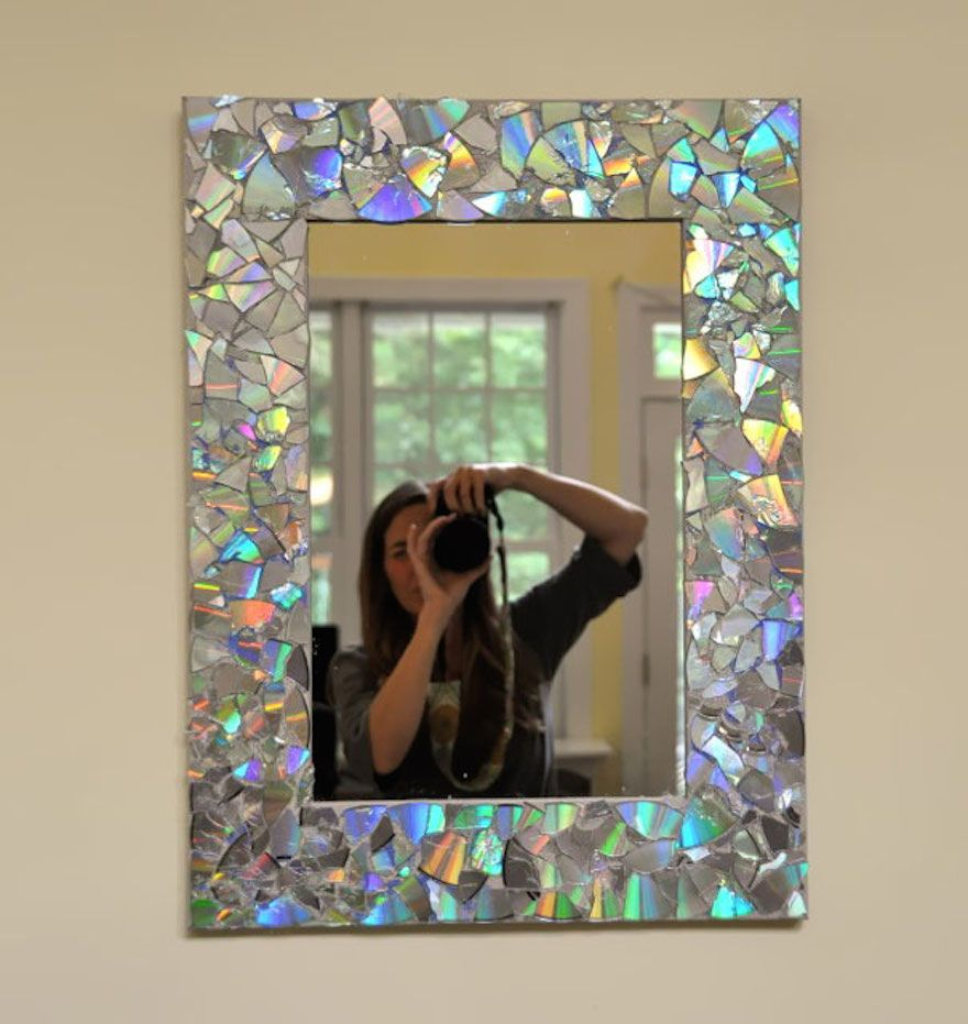 Really neat and creative mirror frame idea made from broken cd ...