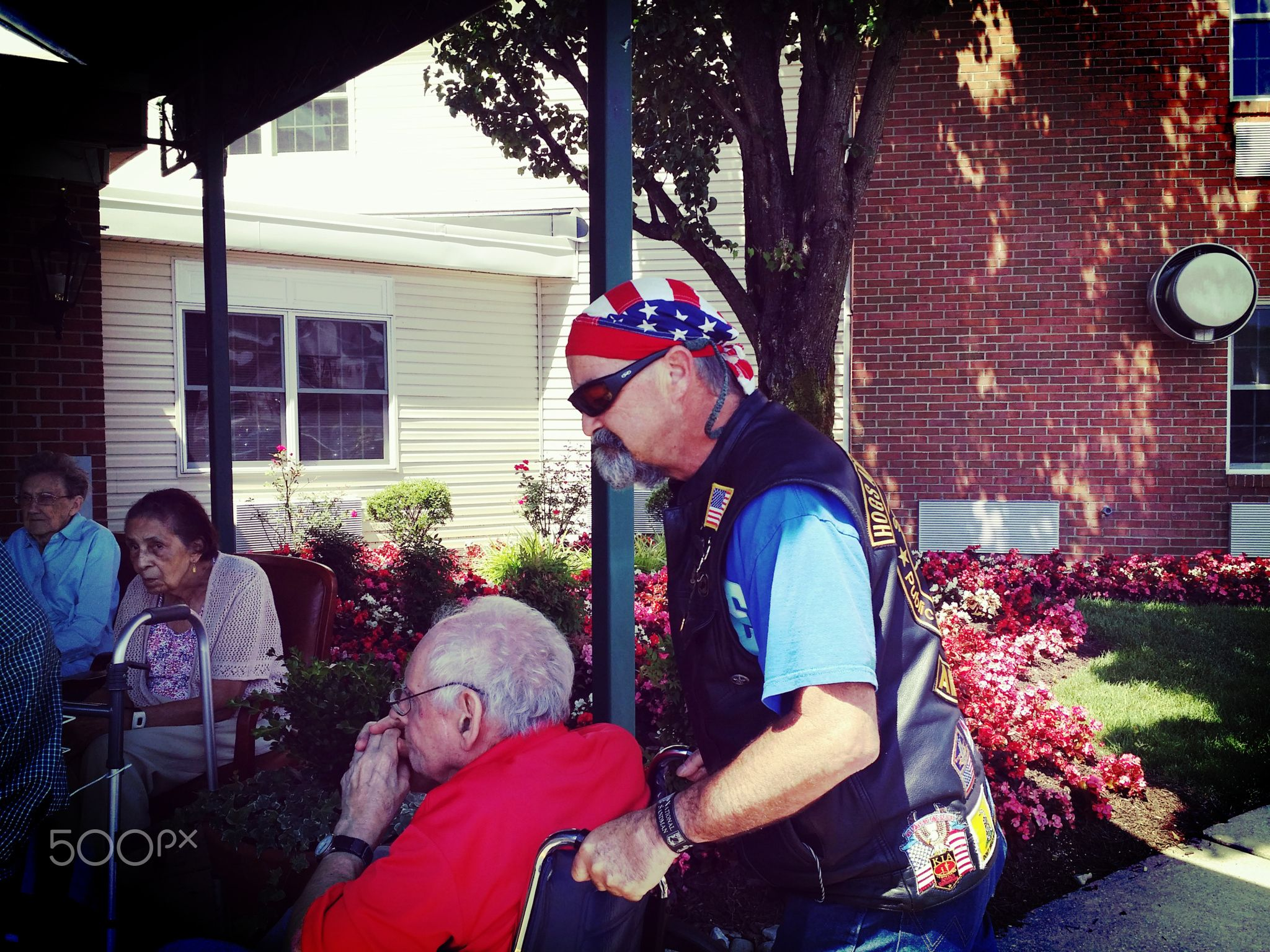 Bikers visiting Senior Citizens - We returned to an assisted living facility to visit with residents on Saturday. Some are veterans, a few are shy and not so receptive to coming outside and meeting with us and others loved the motorcycles and even got their pictures taken with them. Smiles all around! :)