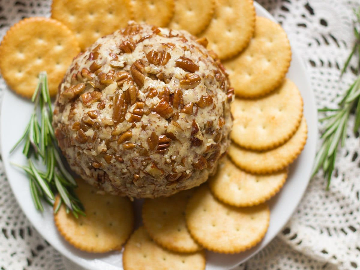 This Vegan Cheese Ball Is Made With Creamy Cashew Cheese Flavored With Maple Syrup And Dijon Mustard Rolled Up And Cov Delicacy Food Vegan Snacks Vegan Cheese