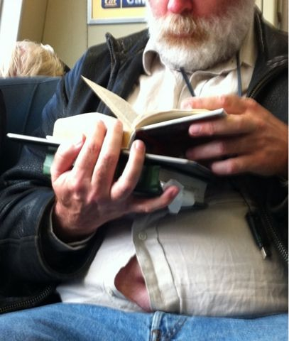 Not only does the man across from me have horrible breath (and naturally, he's a mouth breather), his belly button keeps staring at me.