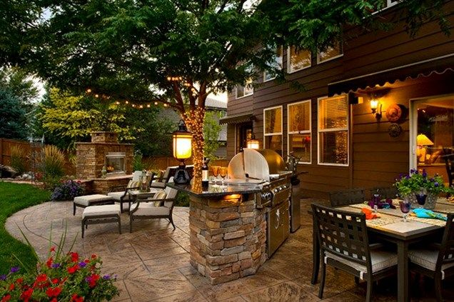 backyard outdoor kitchen area featuring a built in grill and stamped concrete patio - Patio Backyard Ideas