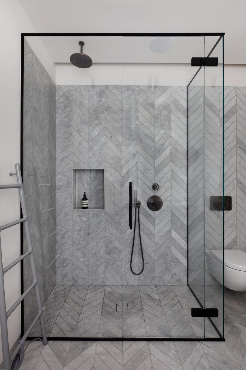 Grey Herringbone Pattern Tiled Bath With Clean Glass Shower And Black Metal Frame Minimalist Bathroom Design Bathroom Tile Designs Bathroom Design