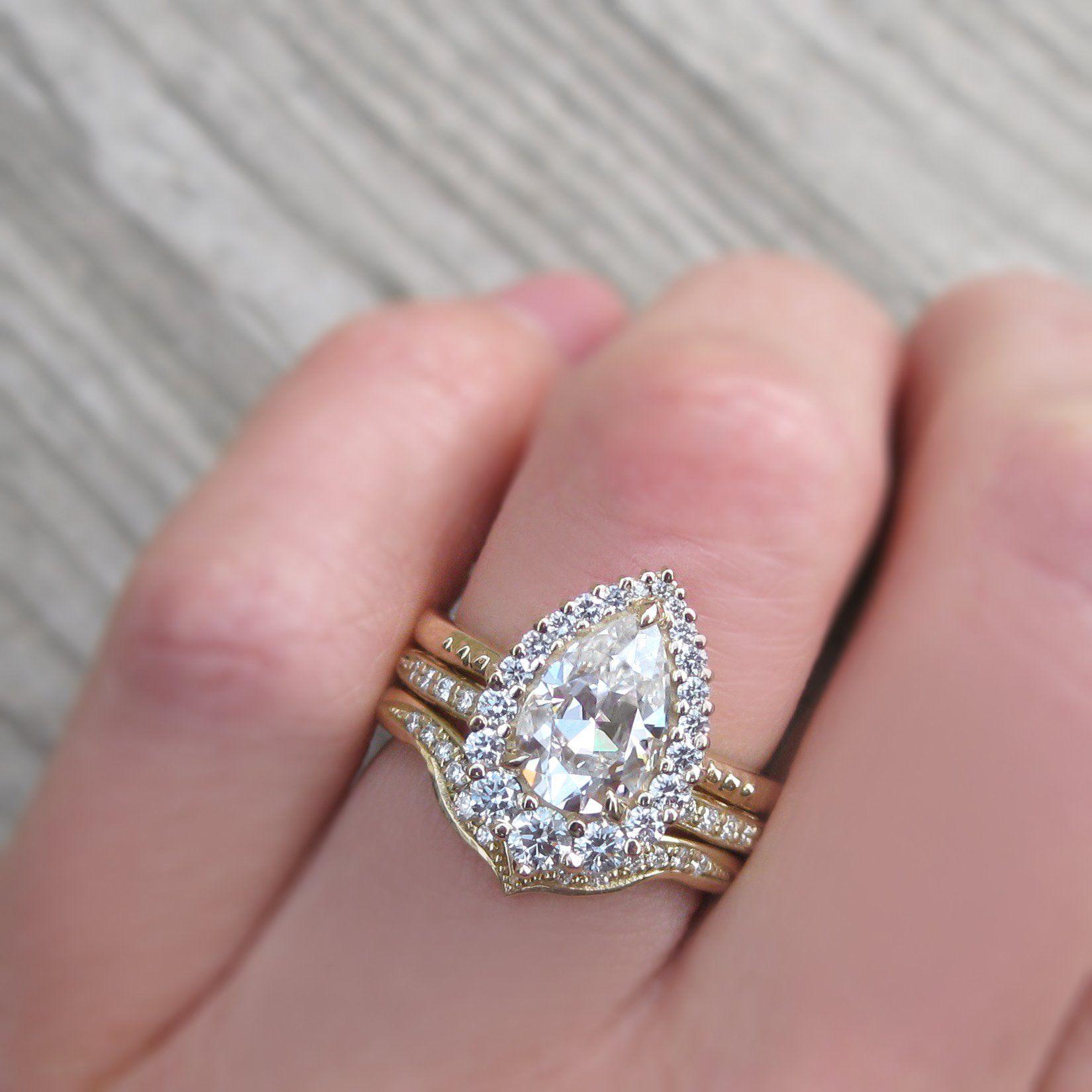 Celeste pear moissanite diamond halo ct moissanite