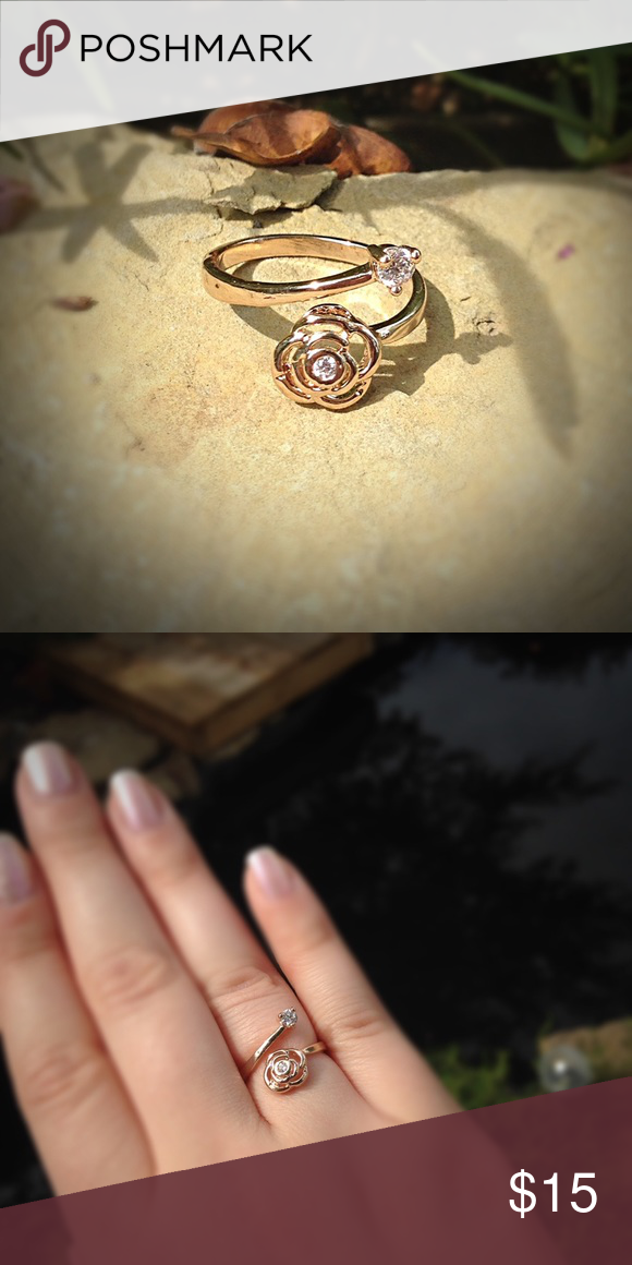 Rose gold tone CZ flower fashion ring Dainty Rose gold tone fashion ring. Fits like a six but is adjustable. Jewelry Rings