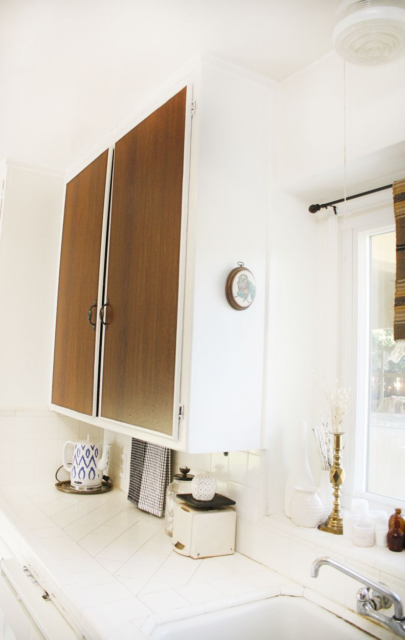 Give your kitchen cabinets a makeover by simply using contact paper!