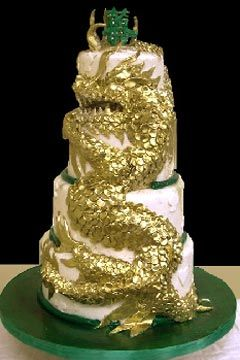 Chinese Four Tier White Green And Gold Dragon Cake Design Decorated With A Indian Wedding CakesIndian