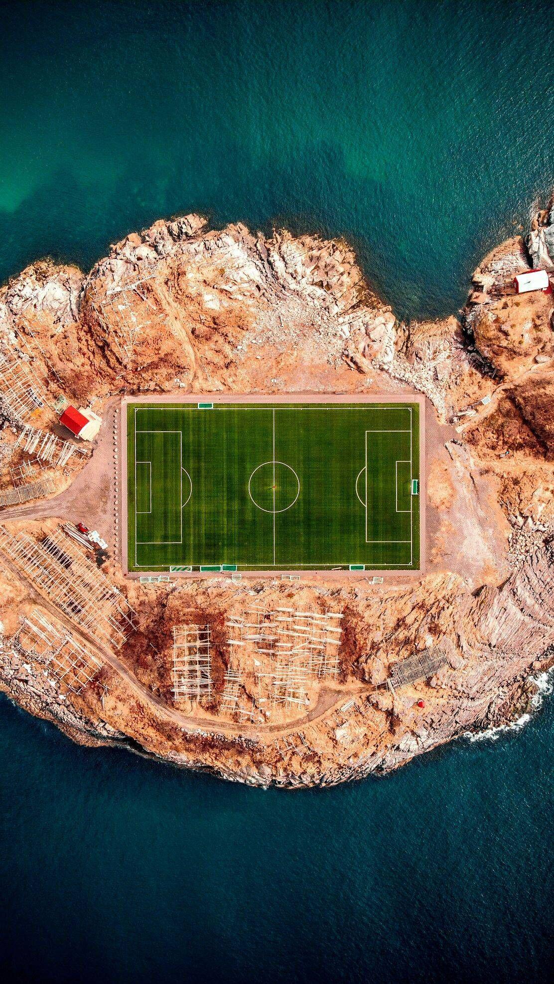 Football Stadium In Henningsvaer Iphone Wallpaper Iphone Wallpapers Photo Drone Photography Aerial Photography