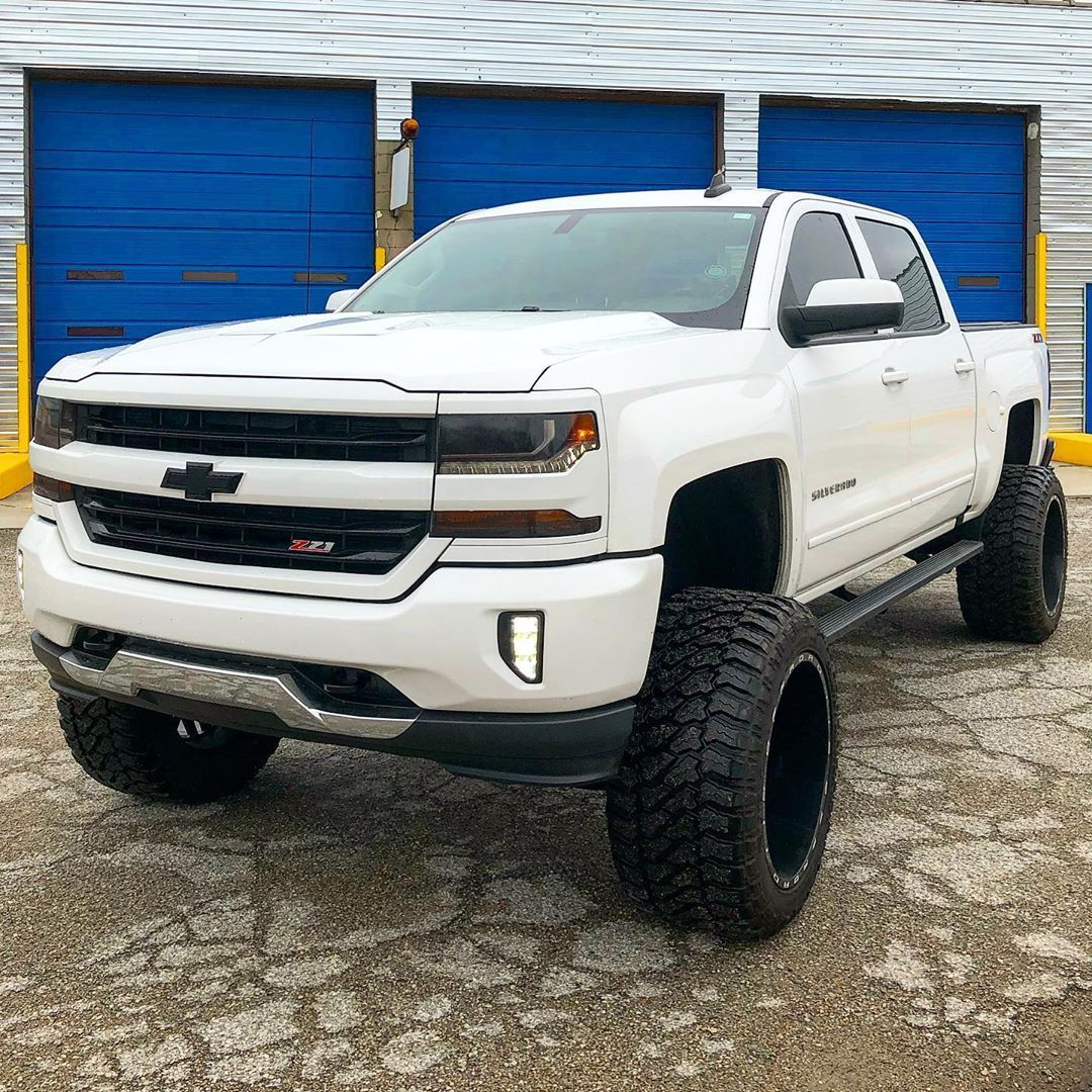 Big Lifted White Chevy Silverado 2500hd With Black Custom Grill In