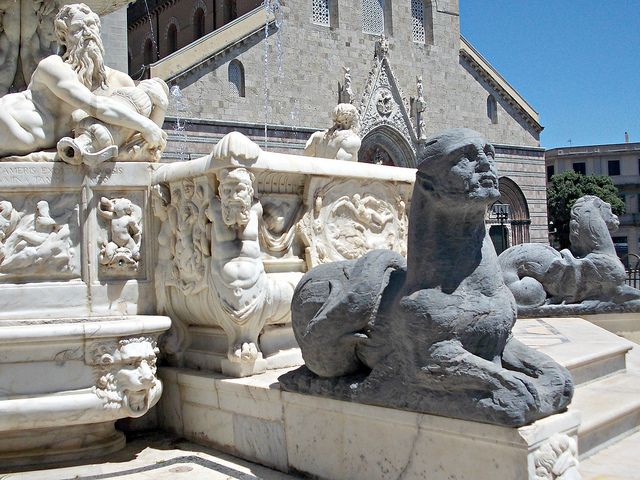 Messina | The charming mid-16th century Fountain of Orion, designed by Montorsoli, who was a pupil of Michelangelo's. Orion was the city of Messina's mythical founder. In the background is part of the facade of the Duomo (Cathedral).