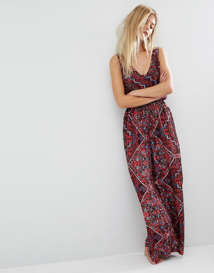 This beautiful patterned jumpsuit reminds me of a persian rug ...