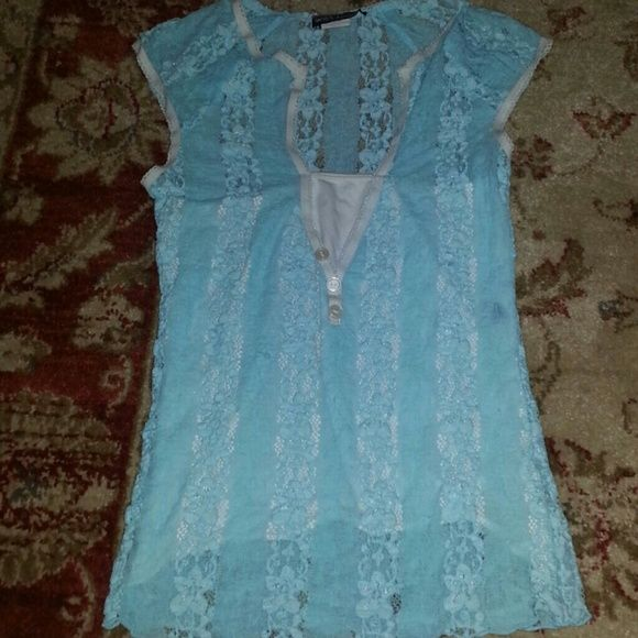 Baby blue lacey floral shirt Its really soft and great for spring time but its a bit too small for me :(  Super cut tho and its in perfect condition! I am willing to negotiate or trade :) Wet Seal Tops