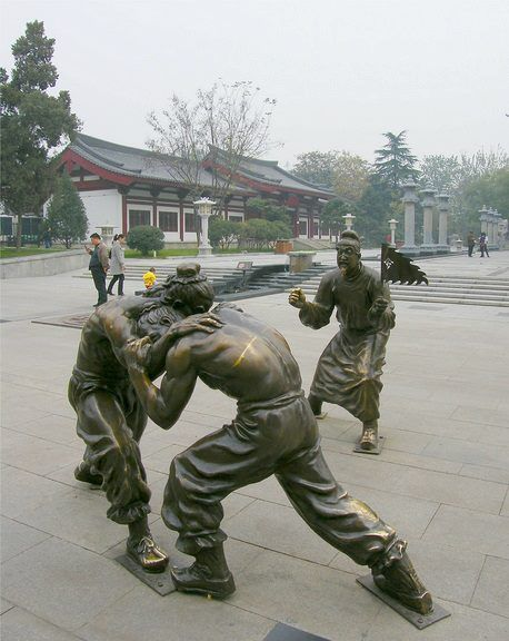 Fighting Statues Street art in Xian China